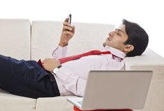 Businessman text messaging on a mobile phone Stock Photography