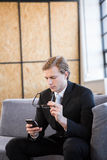 Businessman text messaging on mobile phone Stock Photography