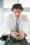 Businessman text messaging on mobile phone Royalty Free Stock Photo