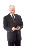 Businessman text messaging on a mobile phone Stock Images