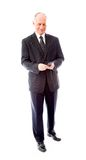 Businessman text messaging on a mobile phone Royalty Free Stock Image