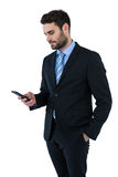 Businessman text messaging on mobile phone Stock Photos