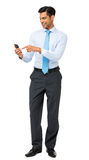 Businessman Text Messaging On Smart Phone Royalty Free Stock Photo