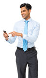 Businessman Text Messaging On Smart Phone Stock Image