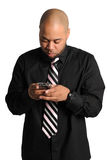 Businessman Texting. African American businessman texting isolated over white background Stock Image