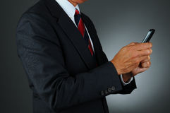 Businessman Texting With Both Hands Royalty Free Stock Images