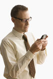 Businessman Texting on a Cell Phone - Isolated Stock Image