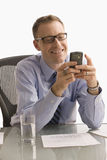 Businessman Texting on Cell Phone - Isolated Royalty Free Stock Images
