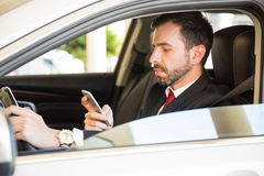 Businessman texting and driving Stock Photos