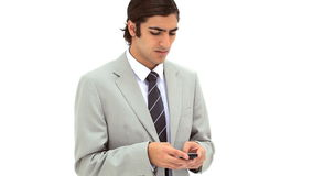 Businessman texting on his mobile phone Stock Photos