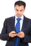 Businessman texting on his phone Stock Photo
