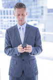 Businessman texting with his smartphone Royalty Free Stock Photos