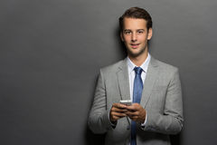 Businessman texting a message Royalty Free Stock Image