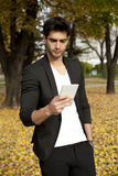 Businessman texting on mobilephone. Outdoor Stock Photography