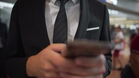 Businessman texting on phone, completing business deals, making appointments. Stock footage stock footage