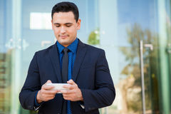 Businessman texting at work Stock Photography