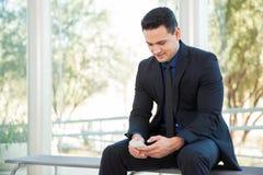 Businessman texting Stock Image