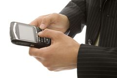 Businessman texts on phone. Businessman uses his thumbs with a mobile device Stock Image
