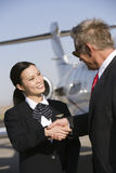 Businessman Thanking Stewardess Royalty Free Stock Image