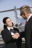 Businessman Thanking Stewardess Royalty Free Stock Image