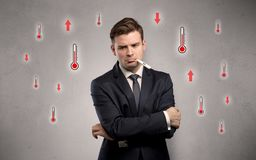 Businessman with thermometer and fever concept stock photos
