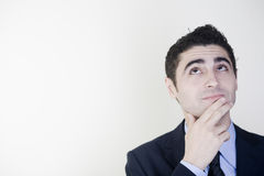 Businessman thinking. Looking to his left with finger on his chest royalty free stock photo