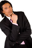 Businessman is thinking. Young indonesian man in a business suit royalty free stock photo