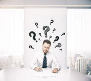 Businessman thinking about answers Stock Photo