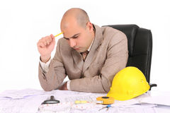 Businessman thinking with architectural plans Royalty Free Stock Images