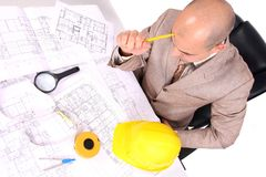 Businessman thinking with architectural plans Royalty Free Stock Image