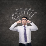 Businessman thinking with arrow sign Stock Image