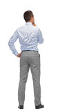 Businessman thinking from back Stock Images