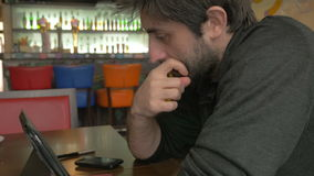 Businessman thinking in a bar stock video footage