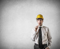 Businessman thinking while biting a pencil Royalty Free Stock Photo