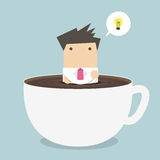 Businessman thinking in a coffee cup Royalty Free Stock Photos