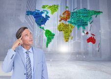 Businessman thinking with Colorful Map with city background Stock Photos