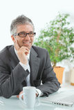 Businessman thinking at desk Stock Photo