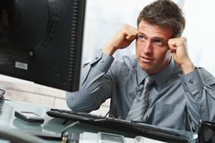 Businessman thinking at desk Stock Photography