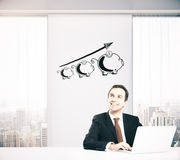 Businessman thinking about financial growth Royalty Free Stock Photo