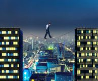 Businessman thinking going the tightrope Royalty Free Stock Photo
