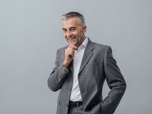Businessman thinking with hand on chin Stock Photography