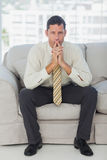 Businessman thinking with hands together Royalty Free Stock Photography