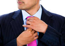 Businessman thinking really hard with hands in front of lips Royalty Free Stock Photography