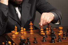 Businessman thinking about her next move in a game of chess Royalty Free Stock Photos