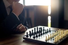 Businessman thinking how to play chess concept business strategy. For win Royalty Free Stock Photography
