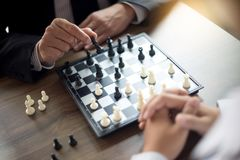 Businessman thinking how to play chess concept business strategy. For win Royalty Free Stock Images