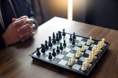 Businessman thinking how to play chess concept business strategy. For win Stock Image