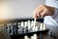 Businessman thinking how to play chess concept business strategy. For win Stock Photo