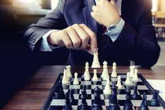 Businessman thinking how to  win. Businessman thinking how to play chess concept business strategy for win Royalty Free Stock Photo