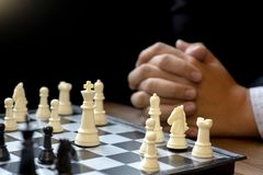 Businessman thinking how to  win. Businessman thinking how to play chess concept business strategy for win Royalty Free Stock Image